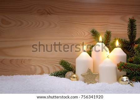 Four burning Advent candles.