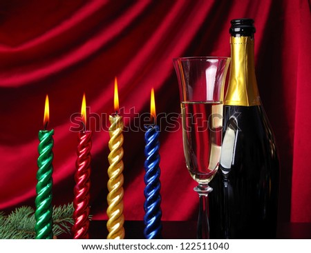 Four burning candle and   goblet of champagne  against purple drapery - stock photo