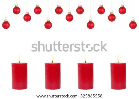 Four burning red candles and christmas tree balls in front of white background - stock photo