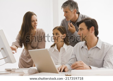 Four business executives discussing in an office - stock photo