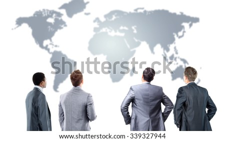 four business mans from the back - looking at the world - stock photo
