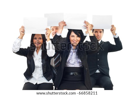 Four business people sitting on chairs and raising blank papers overhead