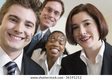 Four business people smiling