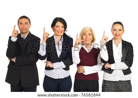 Four business people standing in a row and pointing up isolated on white background - stock photo