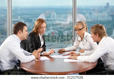 Four businessmen are engaged in negotiations at office - stock photo