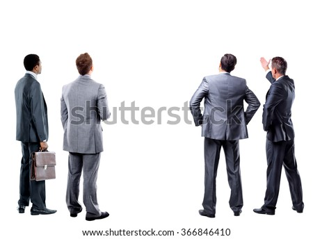 four businessmen standing in front of an empty bacground - stock photo