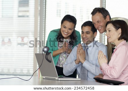 Four Businesspeople Having Video Conference - stock photo