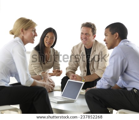 Four Businesspeople in Meeting - stock photo