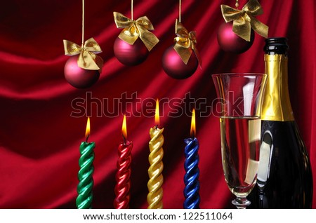 Four candle,  goblet of champagne and new year balls against purple drapery - stock photo