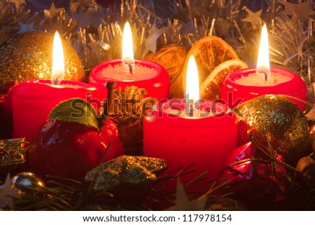 Four candles and christmas decorations. - stock photo