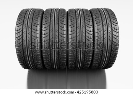 Four car tires on white background. 3d illustration - stock photo