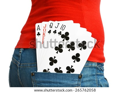 Four cards with a a Joker in a rear pocket of a lady in Jeans - stock photo