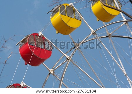 Four cars on a ferris wheel - stock photo