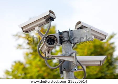 Four CCTV cameras on the junction - stock photo