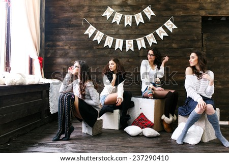 Four charming model posing on a vintage New Year's background - stock photo