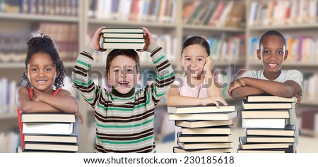 Four children in the library with many books  - stock photo