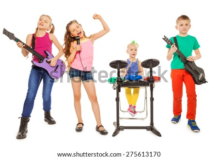 Four children perform together as rock group - stock photo