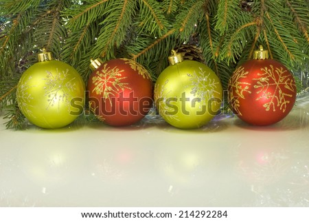 four Christmas balls on the Christmas tree background