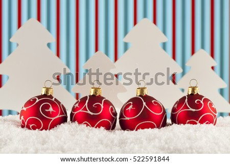 Four Christmas baubles on abstract background