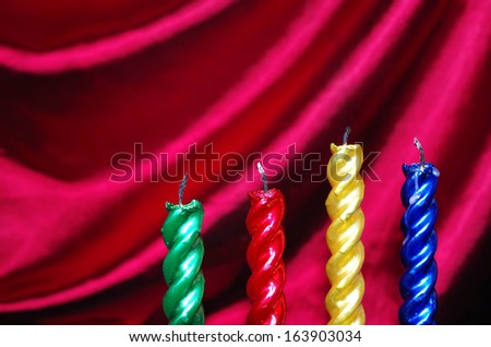 Four  christmas candles  against purple drapery - stock photo