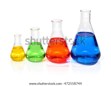 Four clear flasks filled with colorful liquids, arranged by size