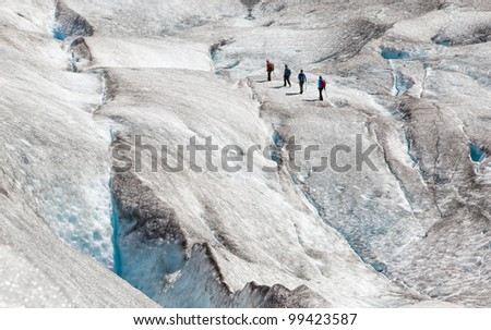 four climbers on ice of norwegian glacier