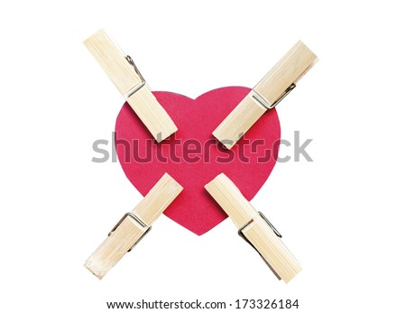 Four clips pinch red heart on white background