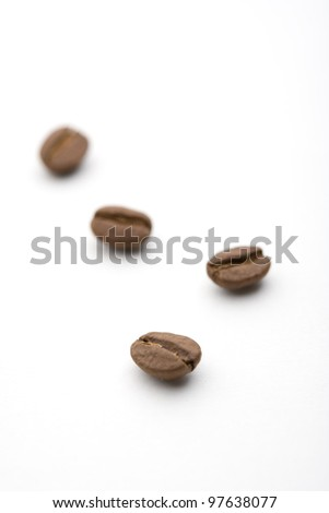Four coffee beans of the white back