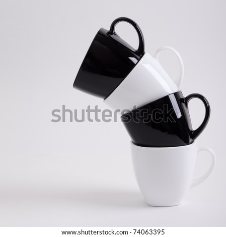 Four Coffee Mugs Design With Copyspace - stock photo