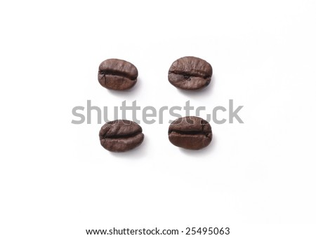 Four coffees beans in top view, on white background