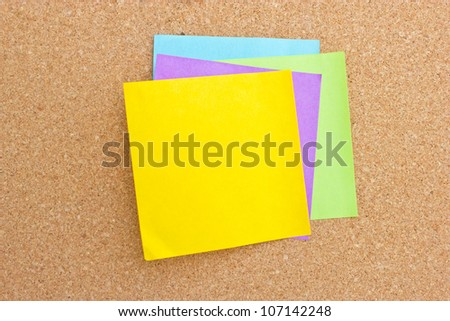 Four color sticky note on board. - stock photo