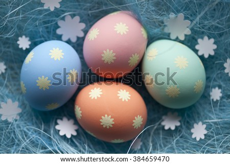 Four colored Easter eggs in the nest - stock photo