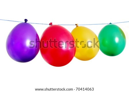 Four colorful balloons in a line on white background - stock photo