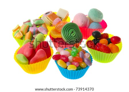Four colorful cups full with assortment candy - stock photo
