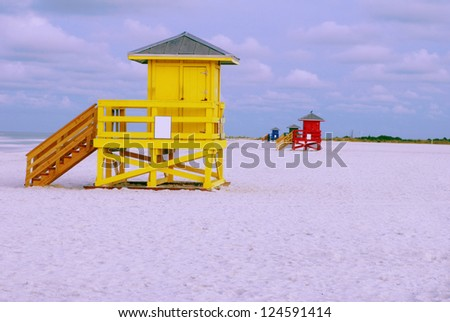 Four colorful lifeguard huts on the beach - stock photo