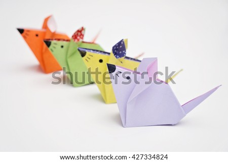 Four colorful mice origami with white background