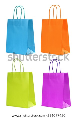 four colorful shopping bags isolated on white - stock photo