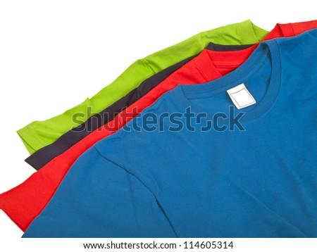 four colorful t shirts isolated on white background - stock photo