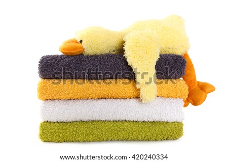 Four colorful towels with yellow plush duck isolated on white background - stock photo