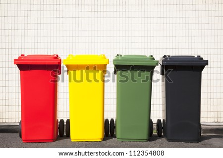 four colors recycle bins on the street - stock photo