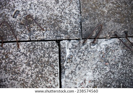 Four concrete blocks with metal loops stacked together - stock photo