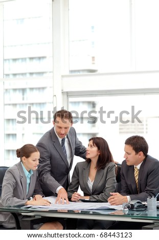 Four coworkers are working in their office - stock photo