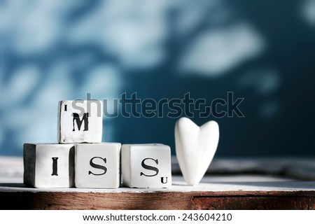 """Four cubes with """" I MISS U """" words,background for valentine's day. - stock photo"""