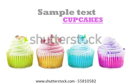 Four cupcakes on a white background with space for text - stock photo