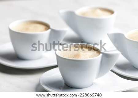 four cups of coffee with milk