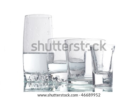 four cups of liquid on a white background - stock photo