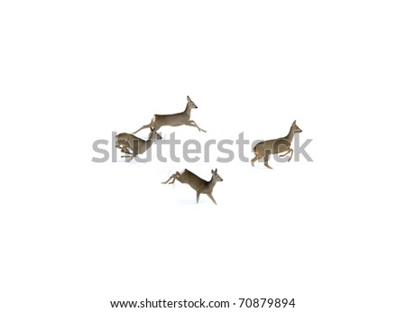 Four deers running on snow