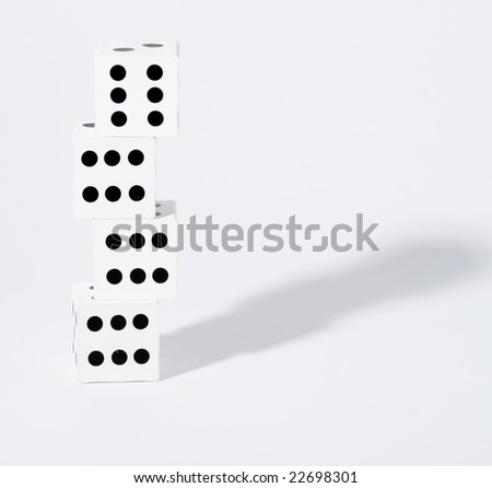 Four dices with number six on top of eachother - stock photo