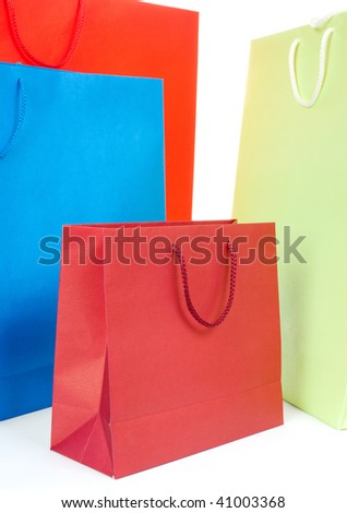 Four different color gift bags on white background - stock photo