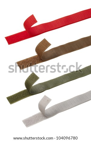 Four different color Velcro strips - stock photo